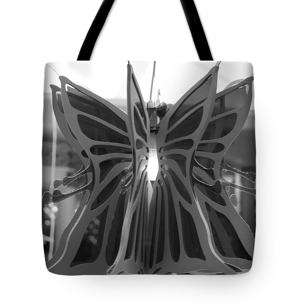 Black And White Tote Bag featuring the photograph Hanging Butterfly by Rob Hans