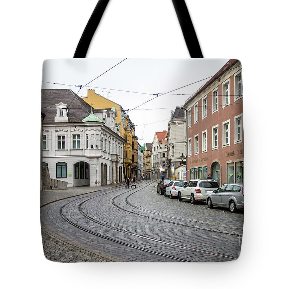 Augsburg Tote Bag featuring the photograph Heading Home by Bernd Billmayer