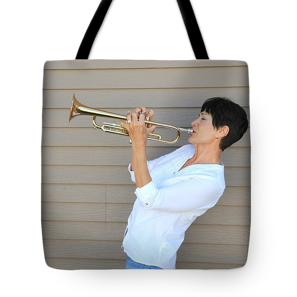 Mature Tote Bag featuring the photograph Jazz Trumpet Player. by Oscar Williams