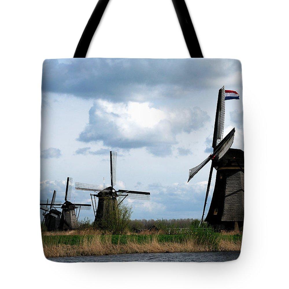 Kinderdijk Tote Bag featuring the photograph Kinderdijk Windmills by Soon Ming Tsang