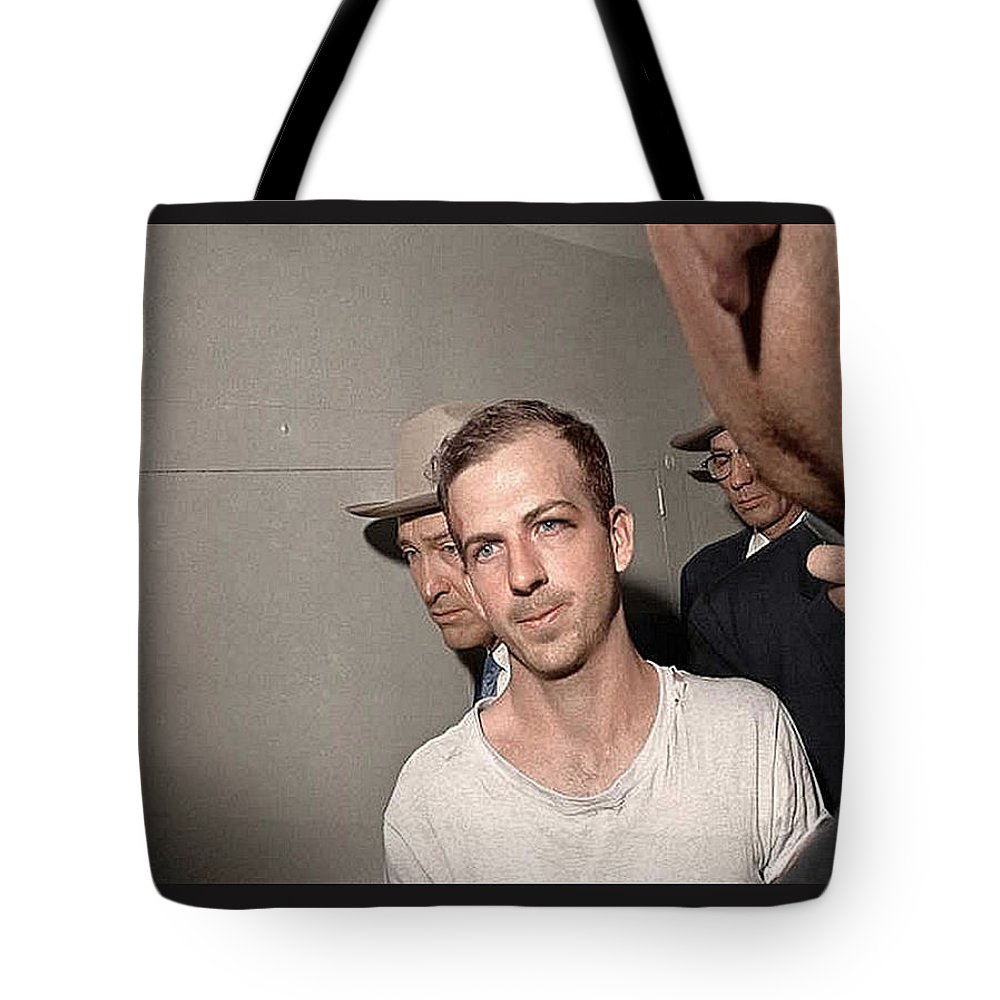 Lee Harvey Oswald Dallas Police Station Dallas Texas Unknown Photographer 1963 Tote Bag featuring the photograph Lee Harvey Oswald Dallas Police Station Dallas Texas Unknown Photographer 1963 by David Lee Guss