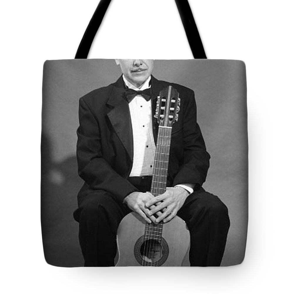Portrait Tote Bag featuring the photograph Man With Guitar by John Graziani