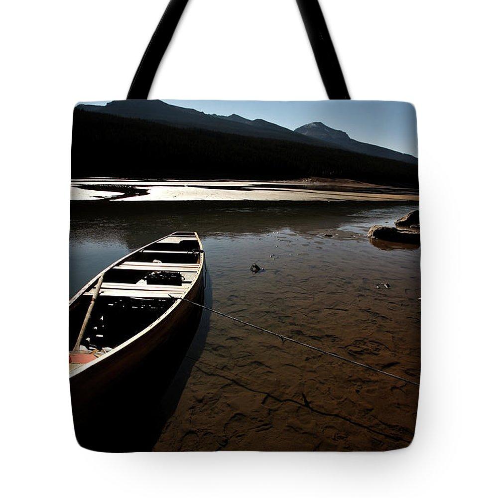Medicine Lake Tote Bag featuring the digital art Medicine Lake In Jasper National Park by Mark Duffy