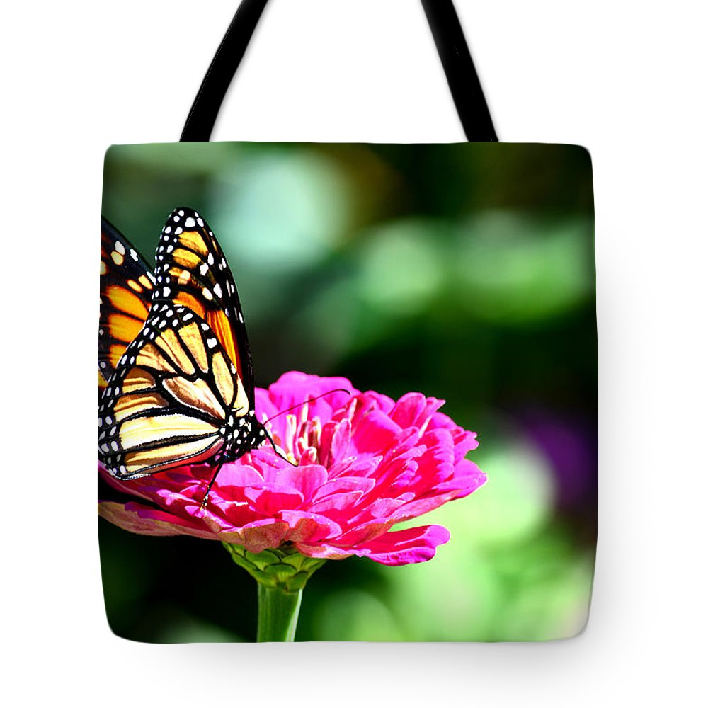 Monarch Tote Bag featuring the photograph Monarch Butterfly On Pink Flower by Reva Steenbergen