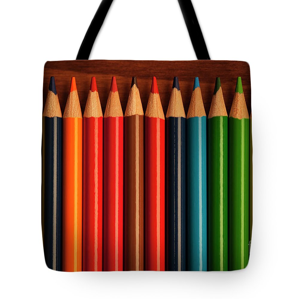 Abstract Tote Bag featuring the photograph Multicolored Pencils In Rows by Jim Corwin