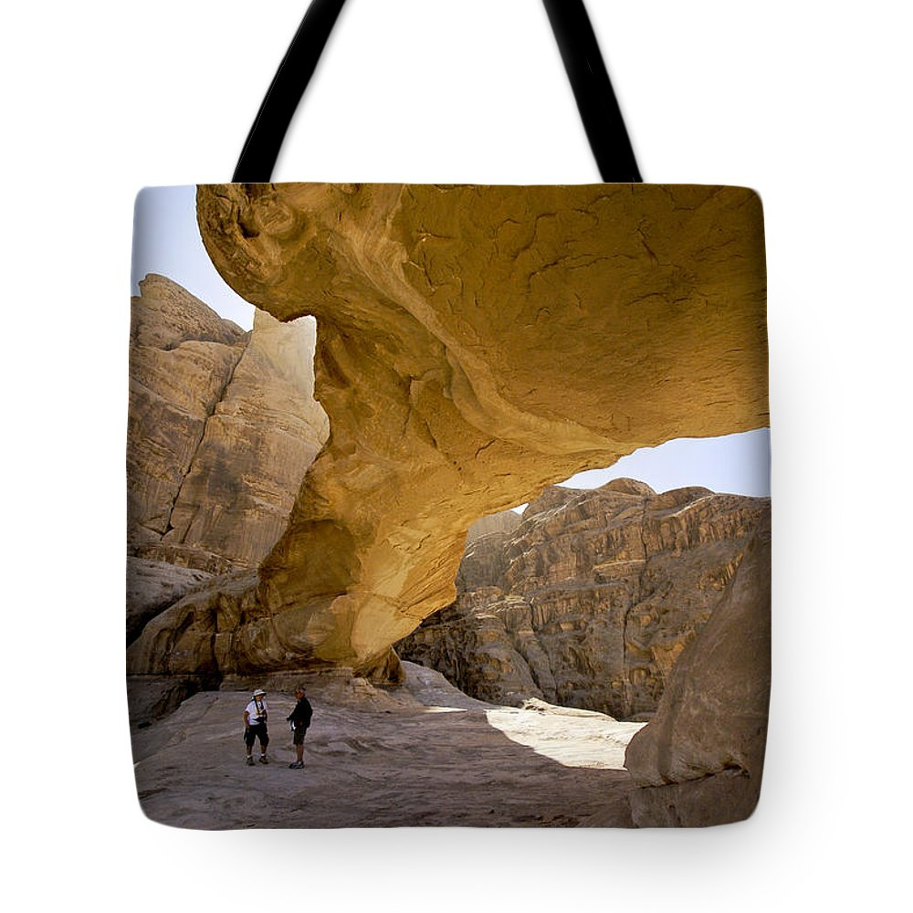 Middle East Tote Bag featuring the photograph Natural Arch In Wadi Rum by Michele Burgess
