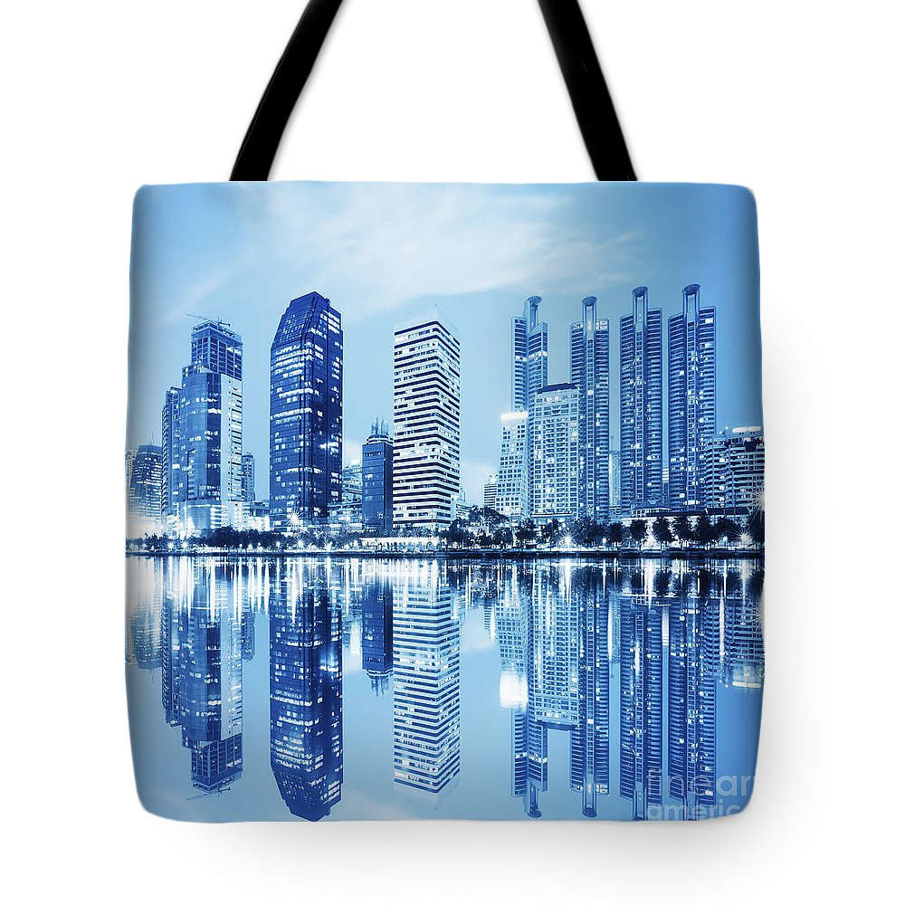 Architecture Tote Bag featuring the photograph Night Scenes Of City by Setsiri Silapasuwanchai