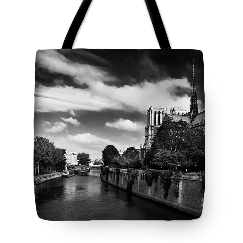 Paris Tote Bag featuring the photograph Notre Dame Cathedral And The River Seine - Paris by Barry O Carroll