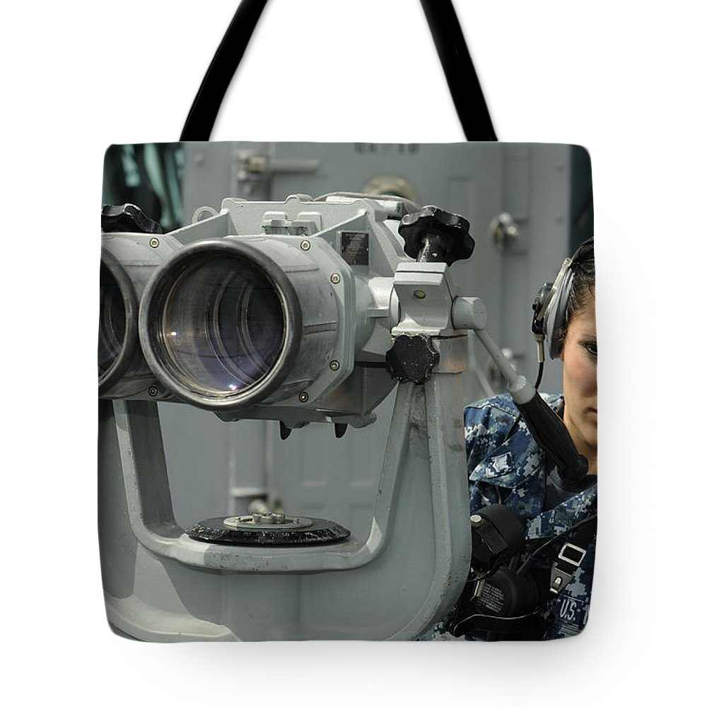 Busan Tote Bag featuring the photograph Operations Specialist Looks by Stocktrek Images