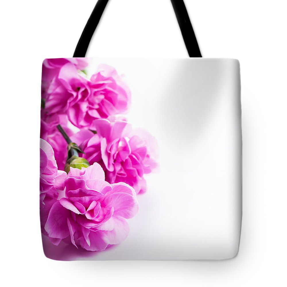 Pink soft spring flowers bouquet on white background tote bag for flowers tote bag featuring the photograph pink soft spring flowers bouquet on white background by michal izmirmasajfo