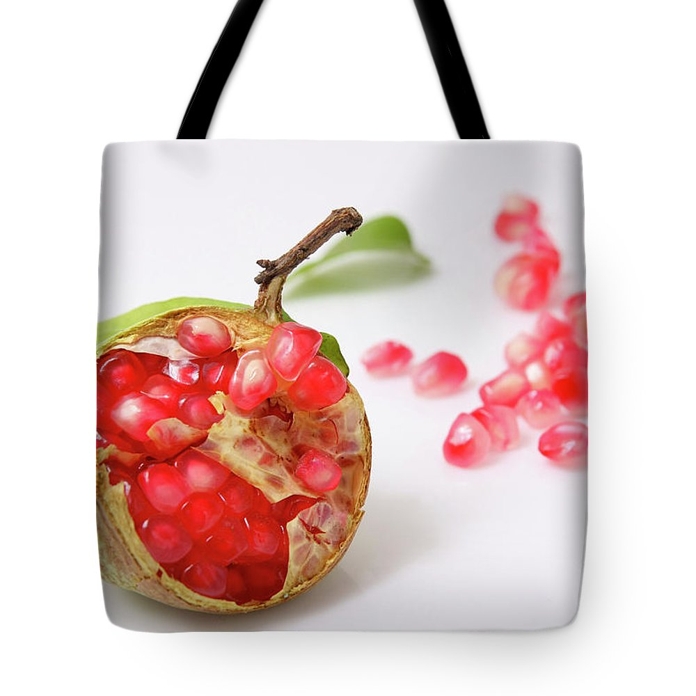 Cut Tote Bag featuring the photograph Pomegranate by Yedidya yos mizrachi