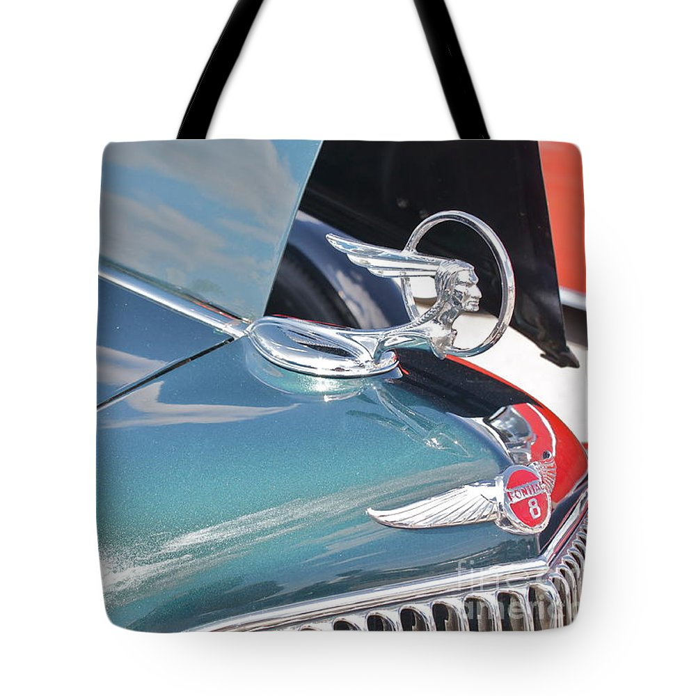Pontiac Tote Bag featuring the photograph 1933 Pontiac Eight Hood Ornament by Linda Bianic