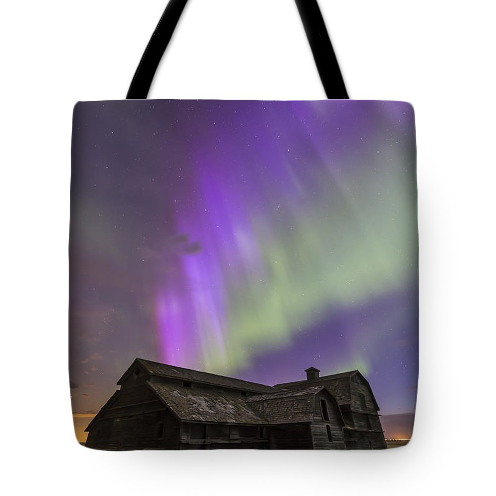 Alberta Tote Bag featuring the photograph Purple Aurora Over An Old Barn by Alan Dyer