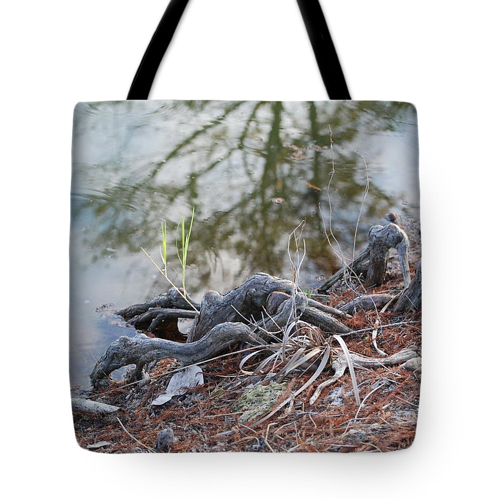 Roots Tote Bag featuring the photograph Rooted Lake Edge by Rob Hans