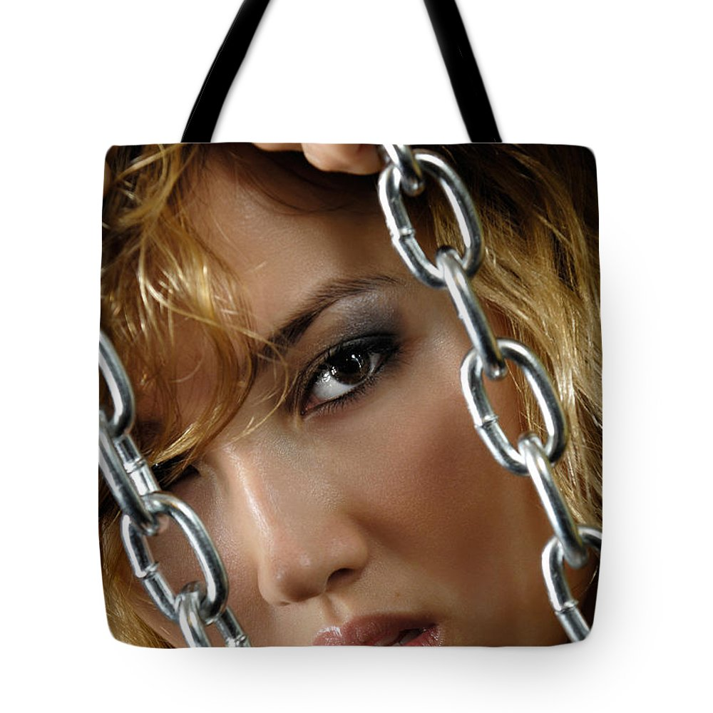 Face Tote Bag featuring the photograph Sensual Woman Face Behind Chains by Oleksiy Maksymenko