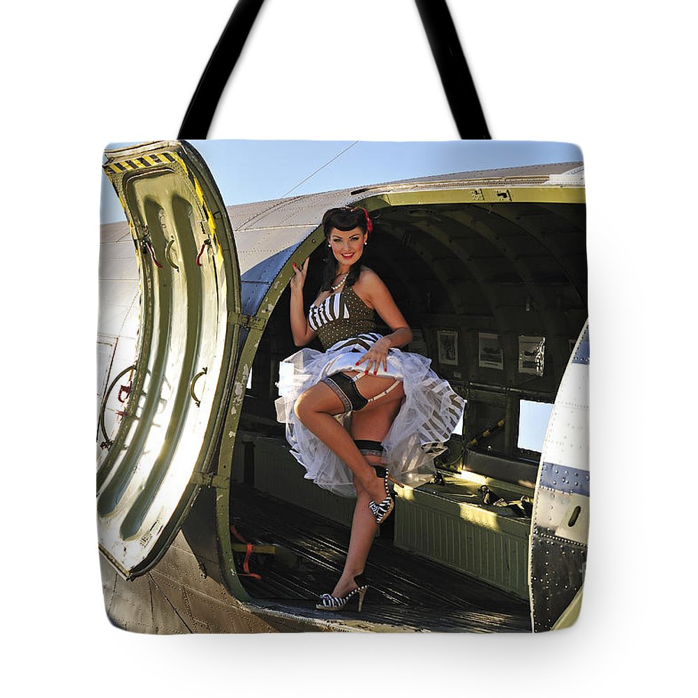 Pin-up Girls Tote Bag featuring the photograph Sexy 1940s Style Pin-up Girl Standing by Christian Kieffer