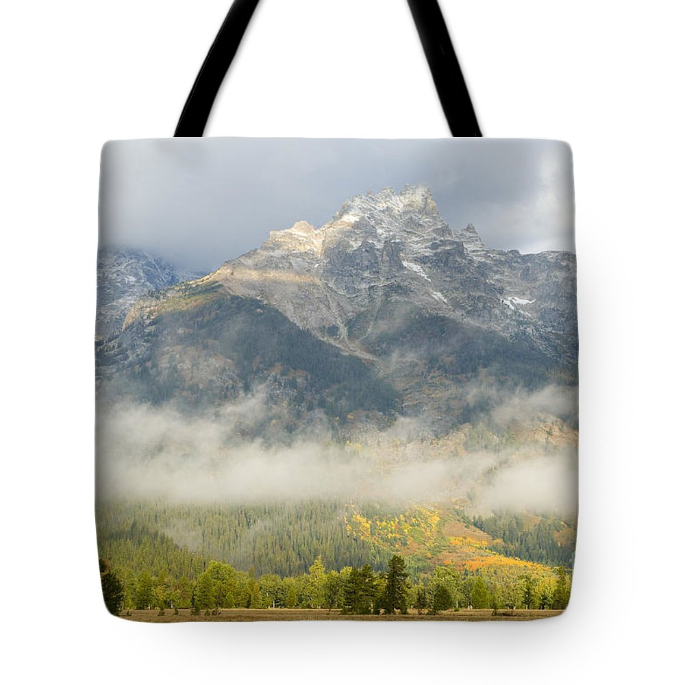 Grand Teton National Park Tote Bag featuring the photograph Storm On Grand Teton by Sandra Bronstein