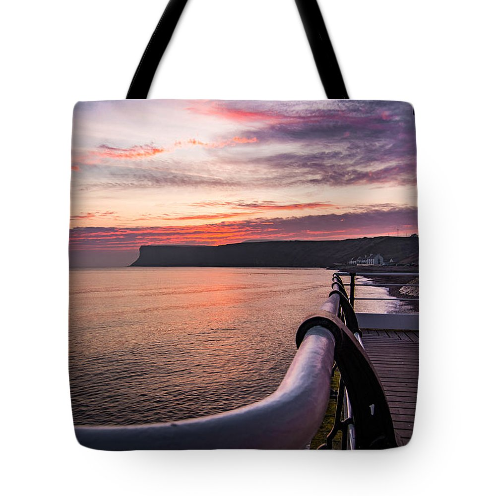 Saltburn Pier.saltburn Tote Bag featuring the photograph Sunrise At Saltburn Pier by Andrew Oxby
