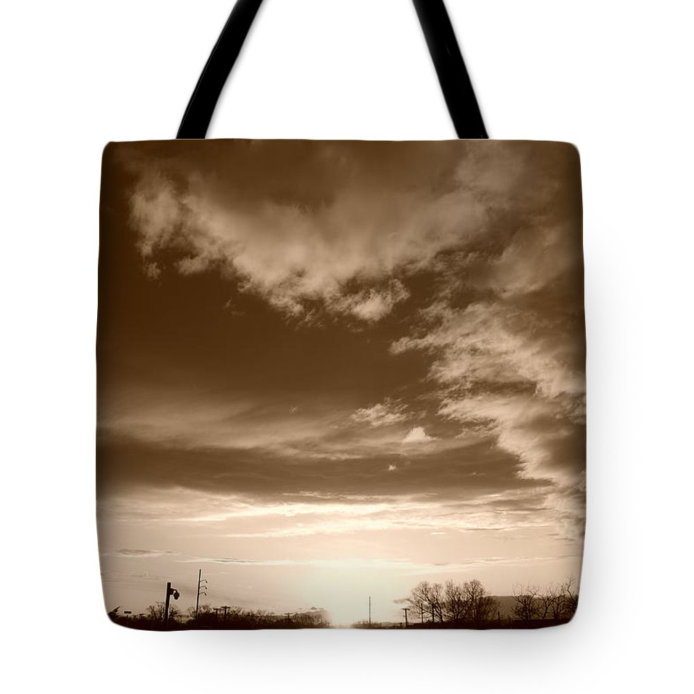 Sunset Tote Bag featuring the photograph Sunset And Clouds by Rob Hans