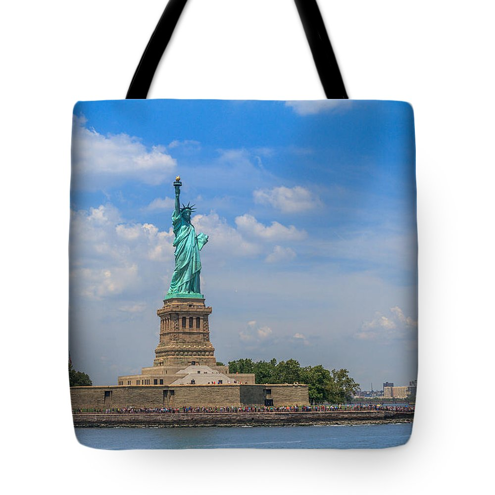 Island Tote Bag featuring the photograph The Statue Of Liberty In New York City by Mina Fouad