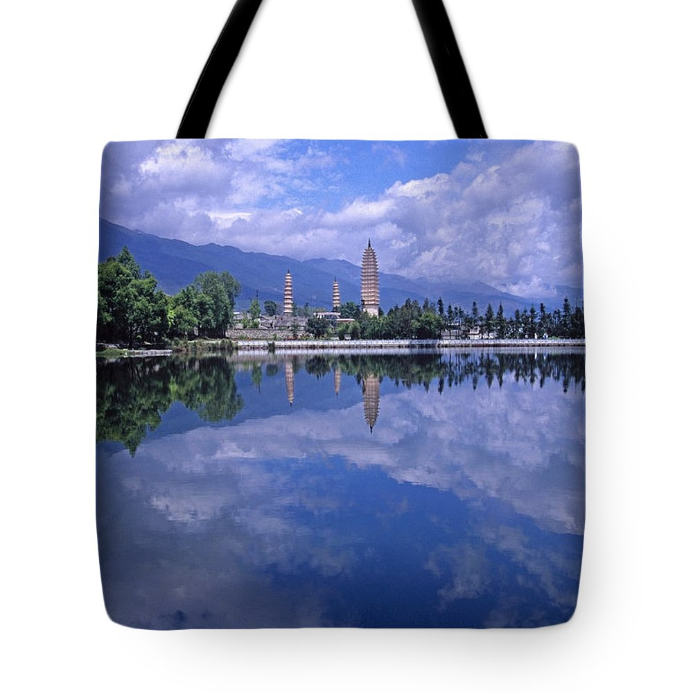 Pagoda Tote Bag featuring the photograph The Three Pagodas Of Dali by Michele Burgess