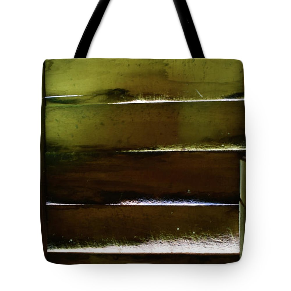 Pat Tote Bag featuring the photograph The Wall by Pat Turner