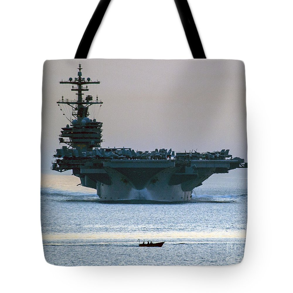 George H.w. Bushgeorge H.w. Bush Carrier Strike Group; Mass Communication Specialist 3rd Class; Abe Mcnatt; Cruiser Tote Bag featuring the painting Uss George H.w. Bush by Celestial Images