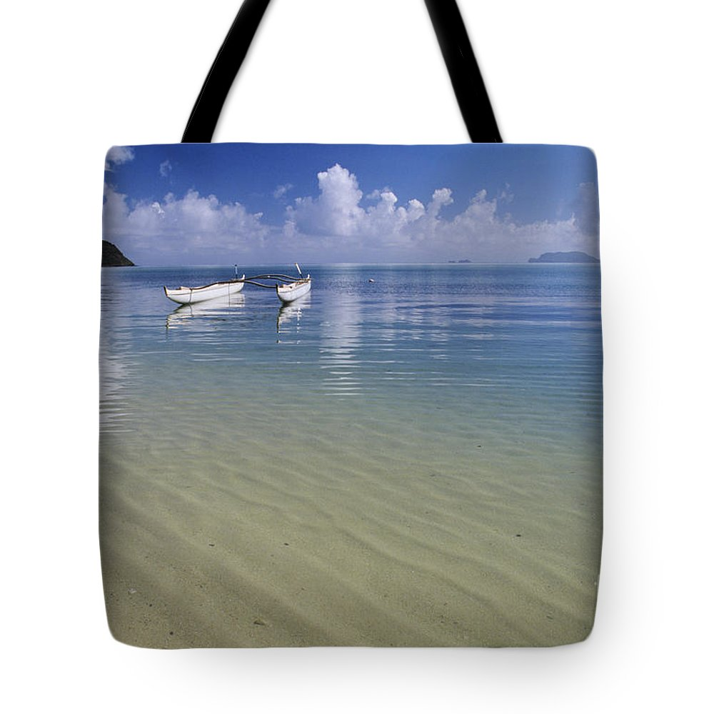 Aku Tote Bag featuring the photograph White Double Hull Canoe by Joss - Printscapes