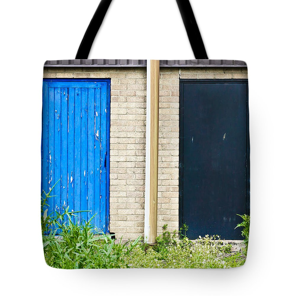 Abstract Tote Bag featuring the photograph Wooden Doors by Tom Gowanlock