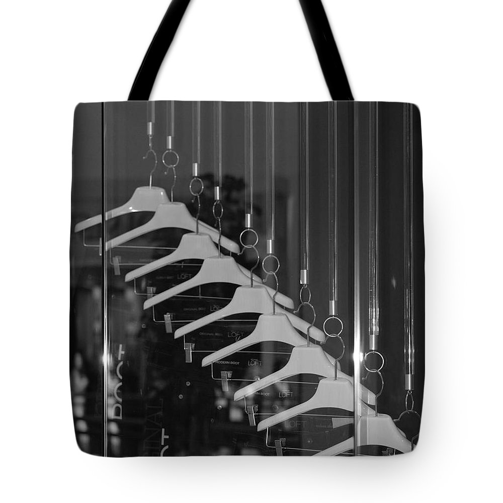 Hangers Tote Bag featuring the photograph 10 Hangers In Black And White by Rob Hans