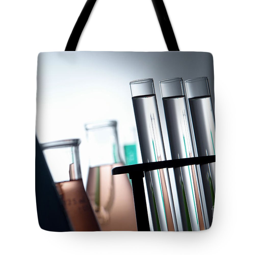 Chemical Tote Bag featuring the photograph Laboratory Test Tubes In Science Research Lab by Olivier Le Queinec