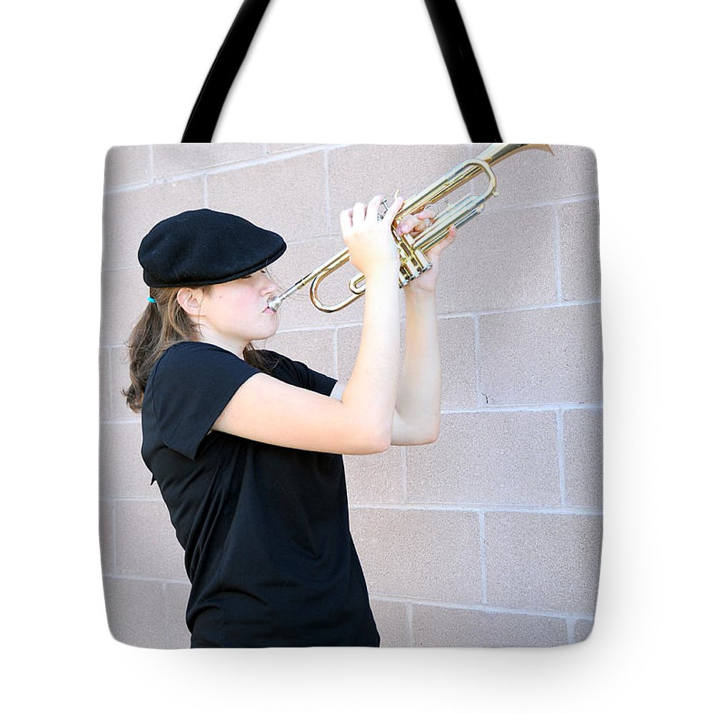 Female Tote Bag featuring the photograph Female Trumpet Player. by Oscar Williams