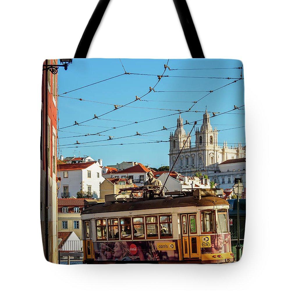 Alfama Tote Bag featuring the photograph Lisbon, Portugal by Karol Kozlowski