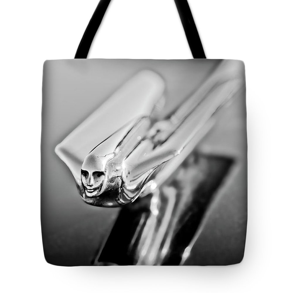 1949 Cadillac Tote Bag featuring the photograph 1949 Cadillac Hood Ornament 4 by Jill Reger