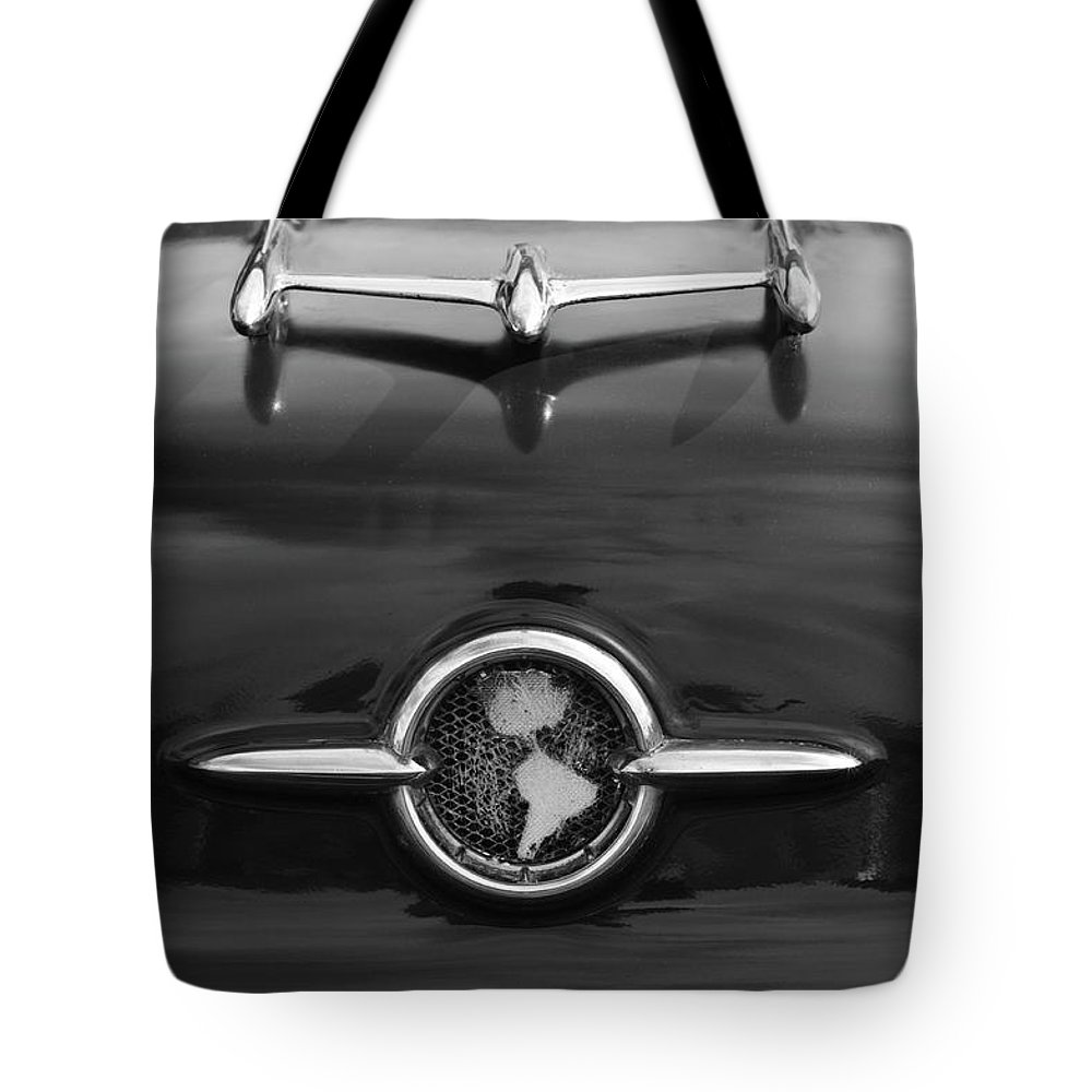 1955 Oldsmobile Holiday 88 Tote Bag featuring the photograph 1955 Oldsmobile Holiday 88 Hood Ornament 2 by Jill Reger