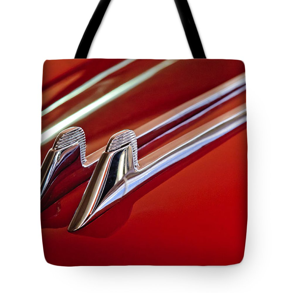 1957 Cadillac Eldorado Biarritz Convertible Tote Bag featuring the photograph 1957 Cadillac Eldorado Biarritz Hood Ornament by Jill Reger