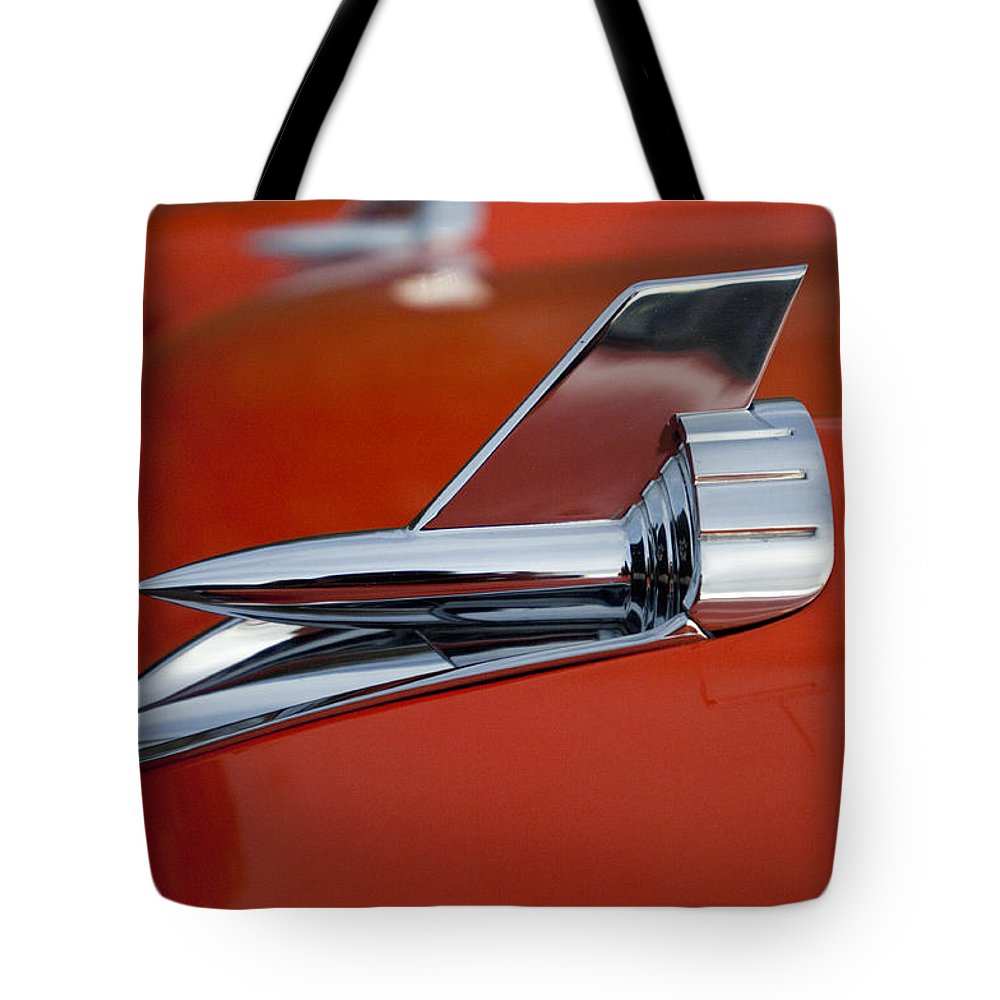 1957 Chevrolet Tote Bag featuring the photograph 1957 Chevrolet Hood Ornament by Jill Reger