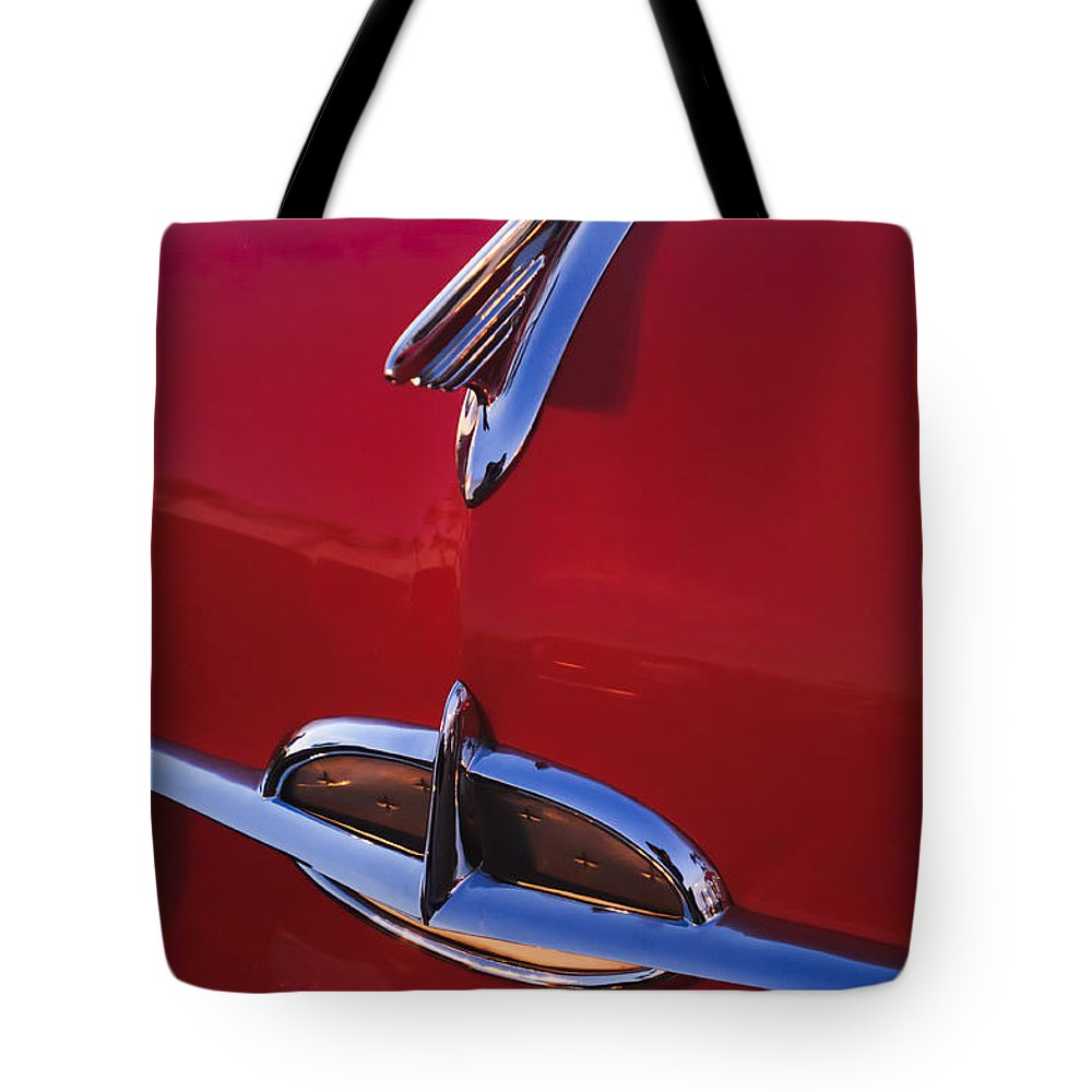 1957 Oldsmobile Tote Bag featuring the photograph 1957 Oldsmobile Hood Ornament 4 by Jill Reger