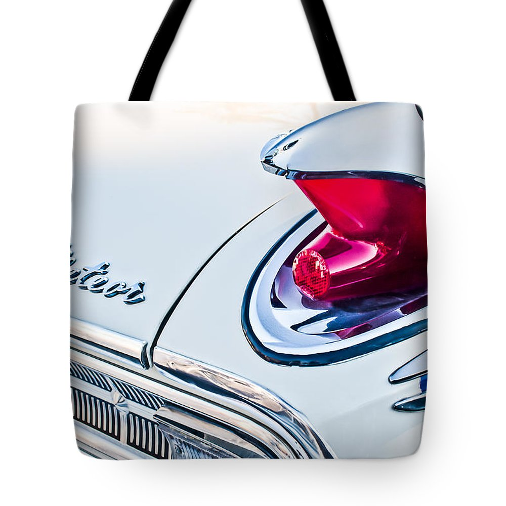 1963 Mercury Meteor Tote Bag featuring the photograph 1963 Mercury Meteor Taillight Emblem by Jill Reger