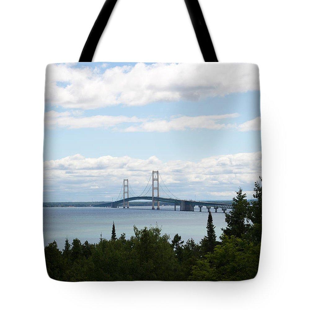 Mackinaw Bridge Tote Bag featuring the photograph Afar by Linda Kerkau