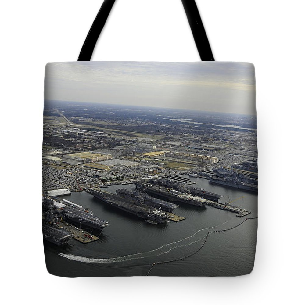 Military Tote Bag featuring the photograph Aircraft Carriers In Port At Naval by Stocktrek Images