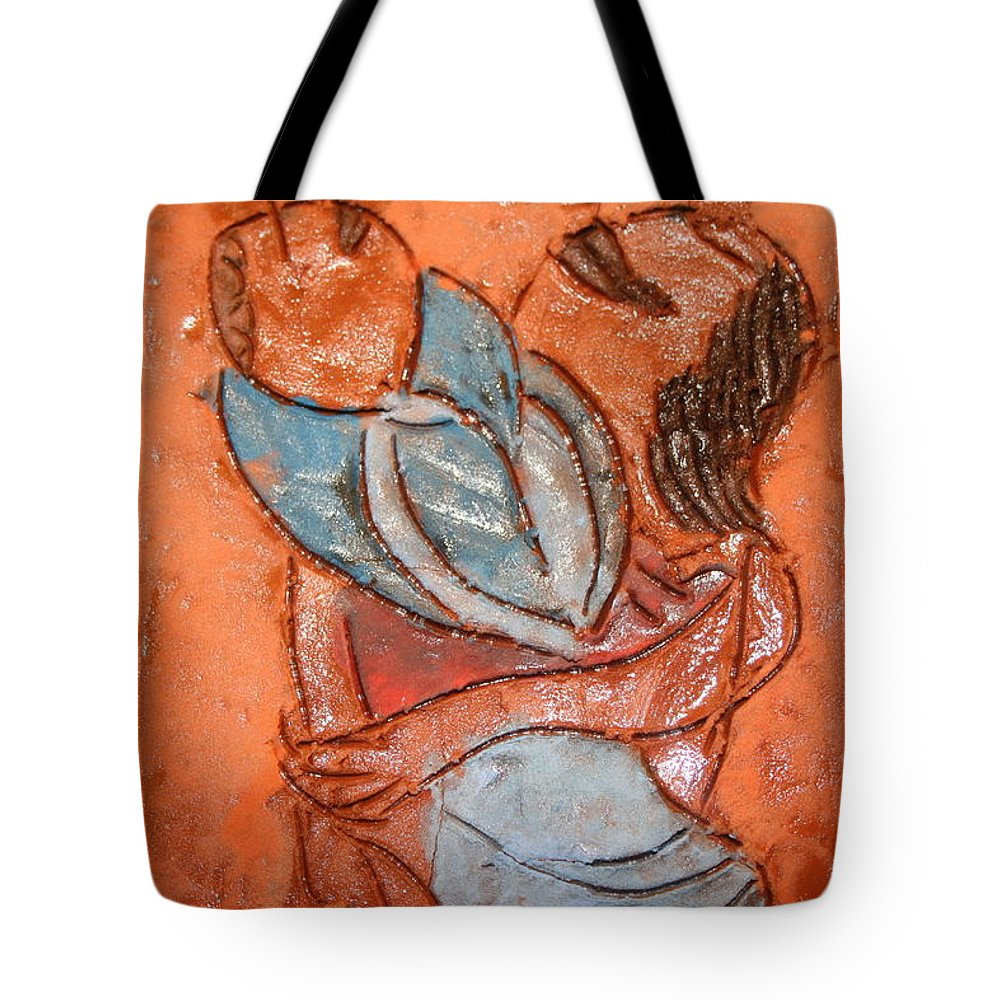 Jesus Tote Bag featuring the ceramic art Amuweese - Tile by Gloria Ssali