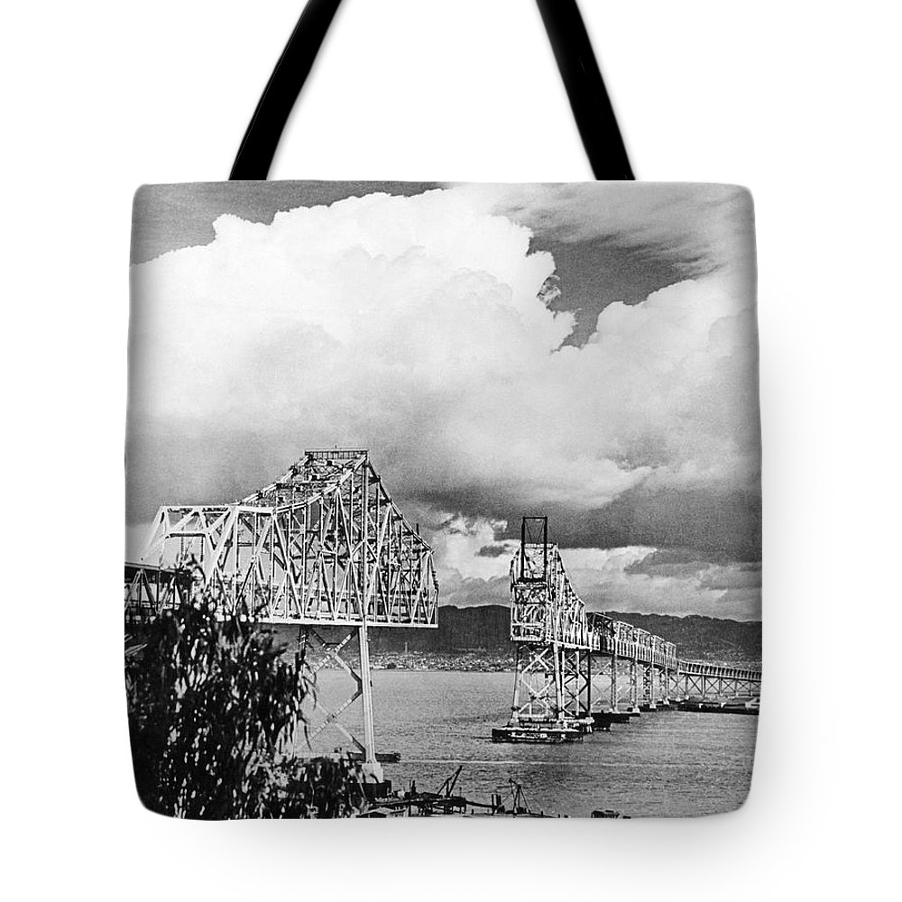 1930s Tote Bag featuring the photograph Bay Bridge Under Construction by Underwood Archives