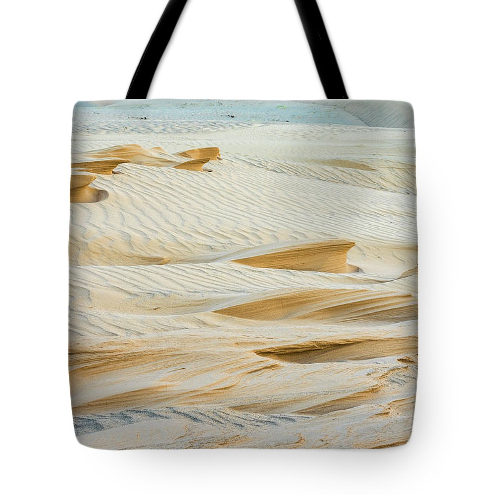 Arid Tote Bag featuring the photograph Close-up Of Beautiful Sunlit Ripple Surface Of Sand In Desert by Oleg Yermolov
