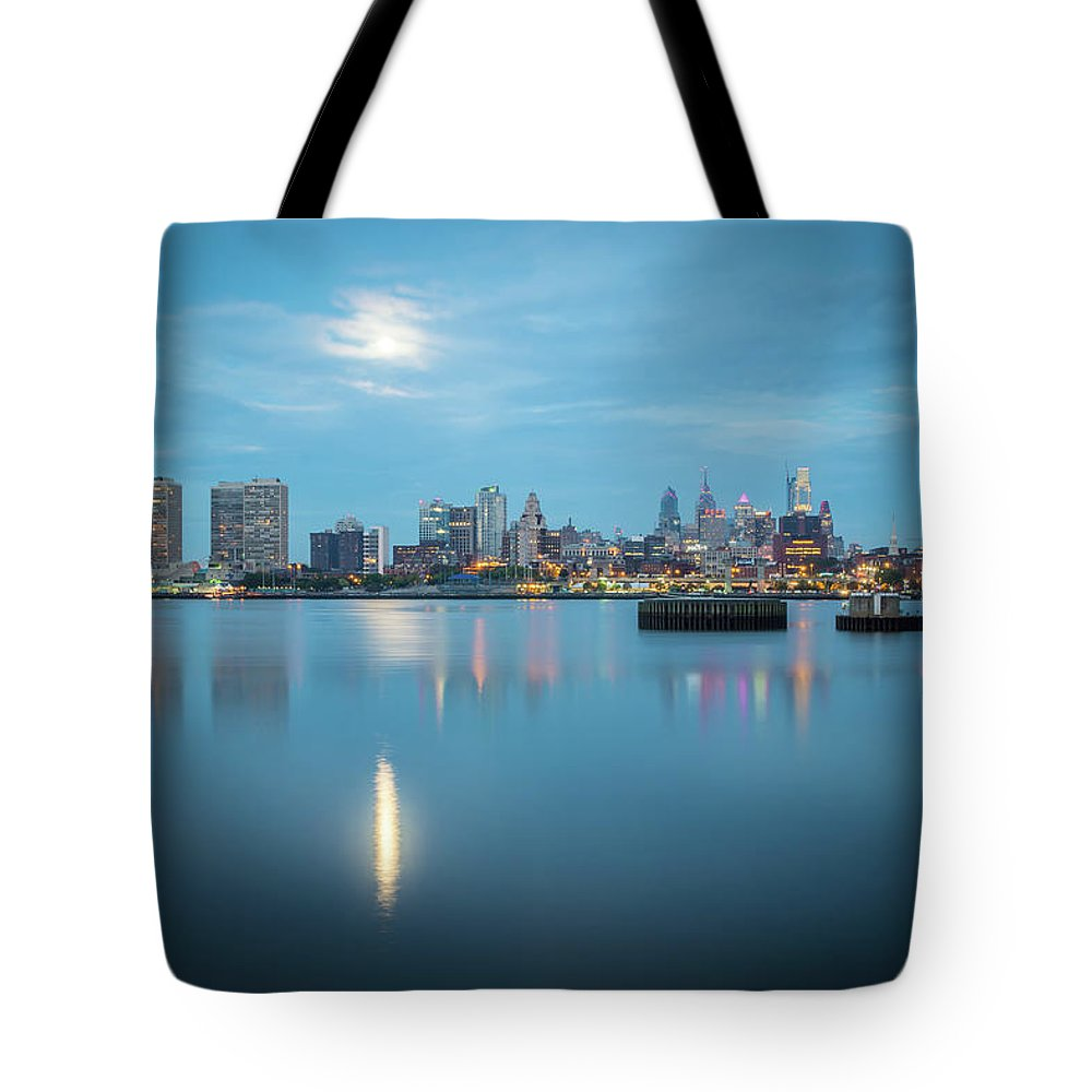 City Tote Bag featuring the photograph early morning sunrise over city of philadelphia PA by Alex Grichenko