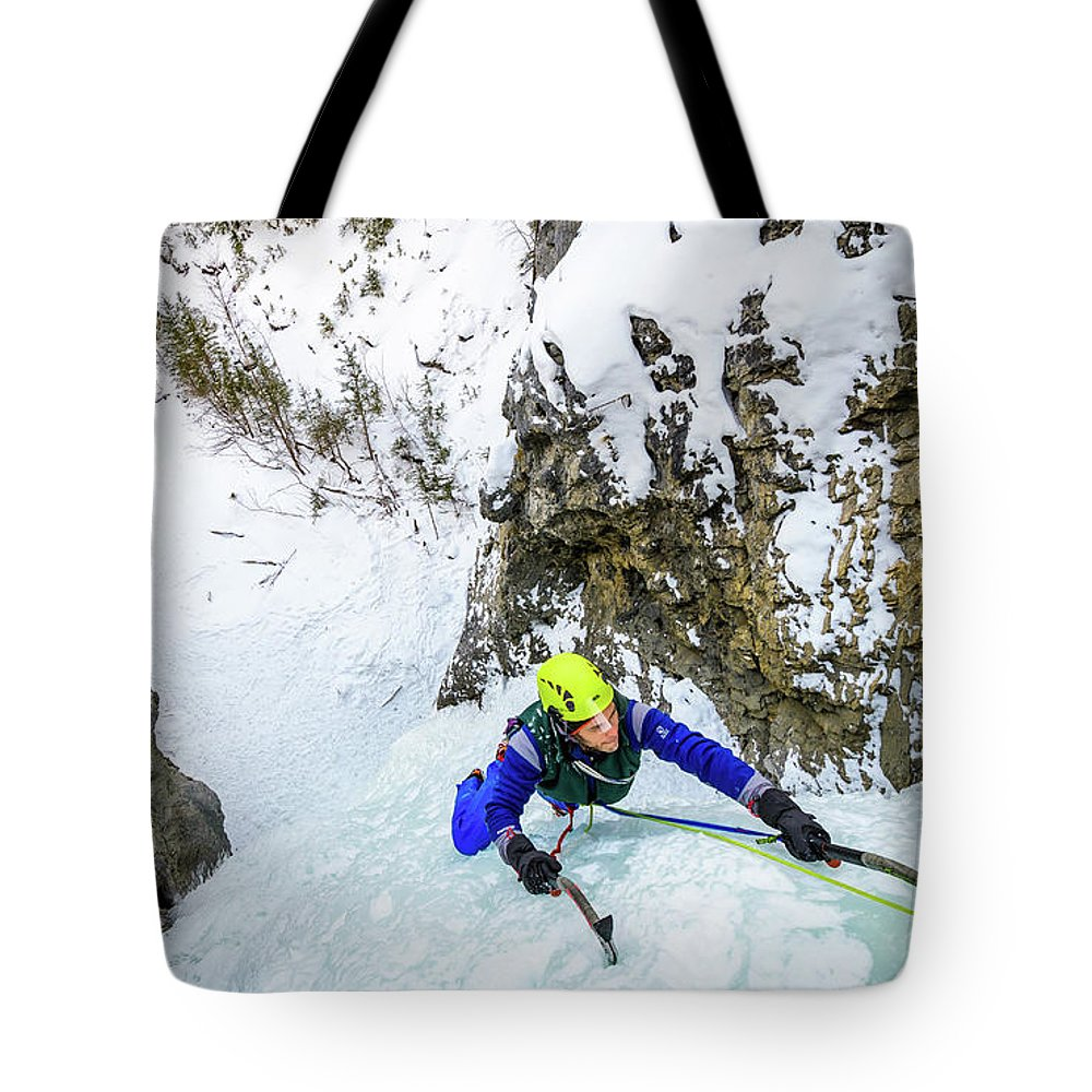 Canada Tote Bag featuring the photograph Ice Climbers On A Route Called Professor Falls Rated Wi4 In Banf by Elijah Weber