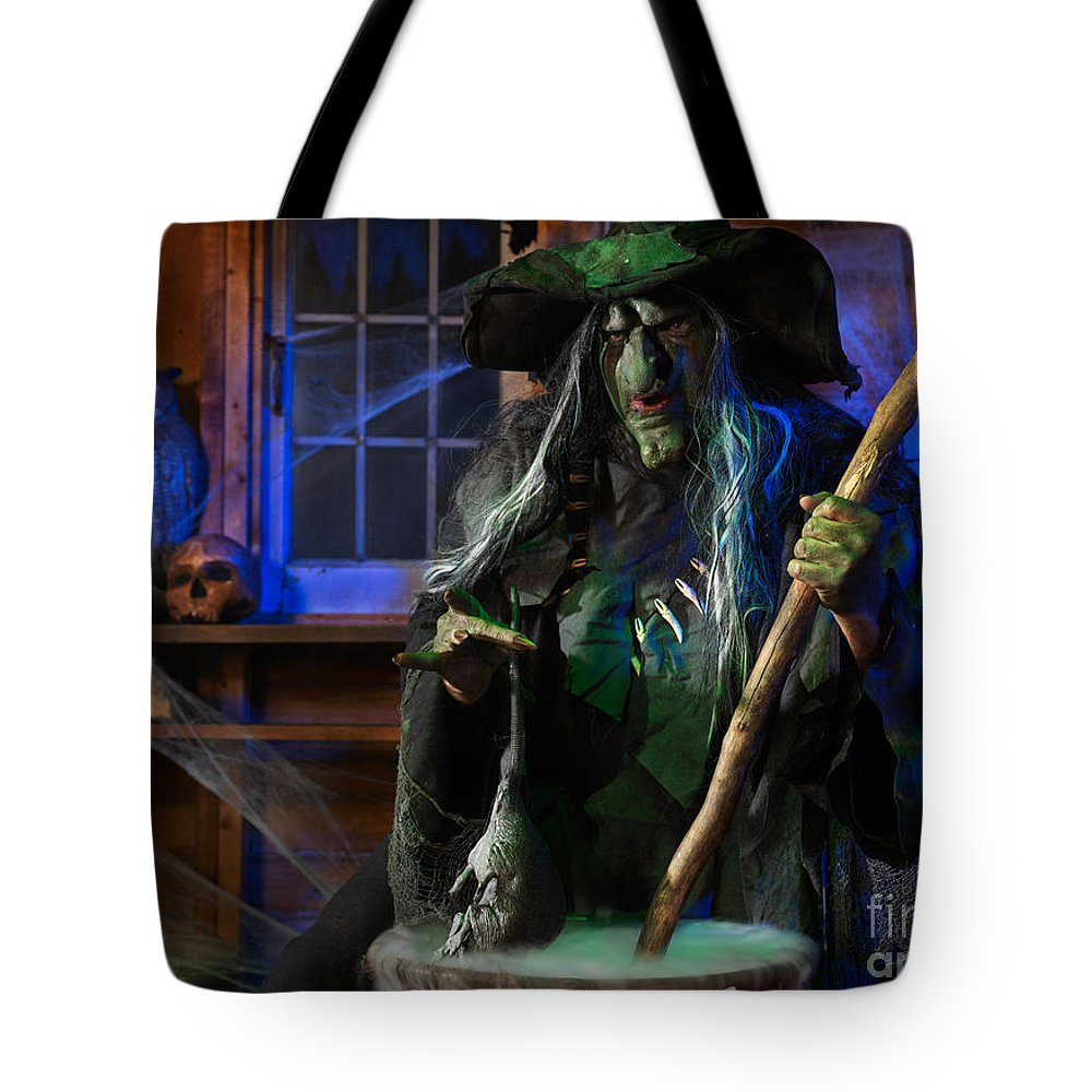 Witch Tote Bag featuring the photograph Scary Old Witch With A Cauldron by Oleksiy Maksymenko