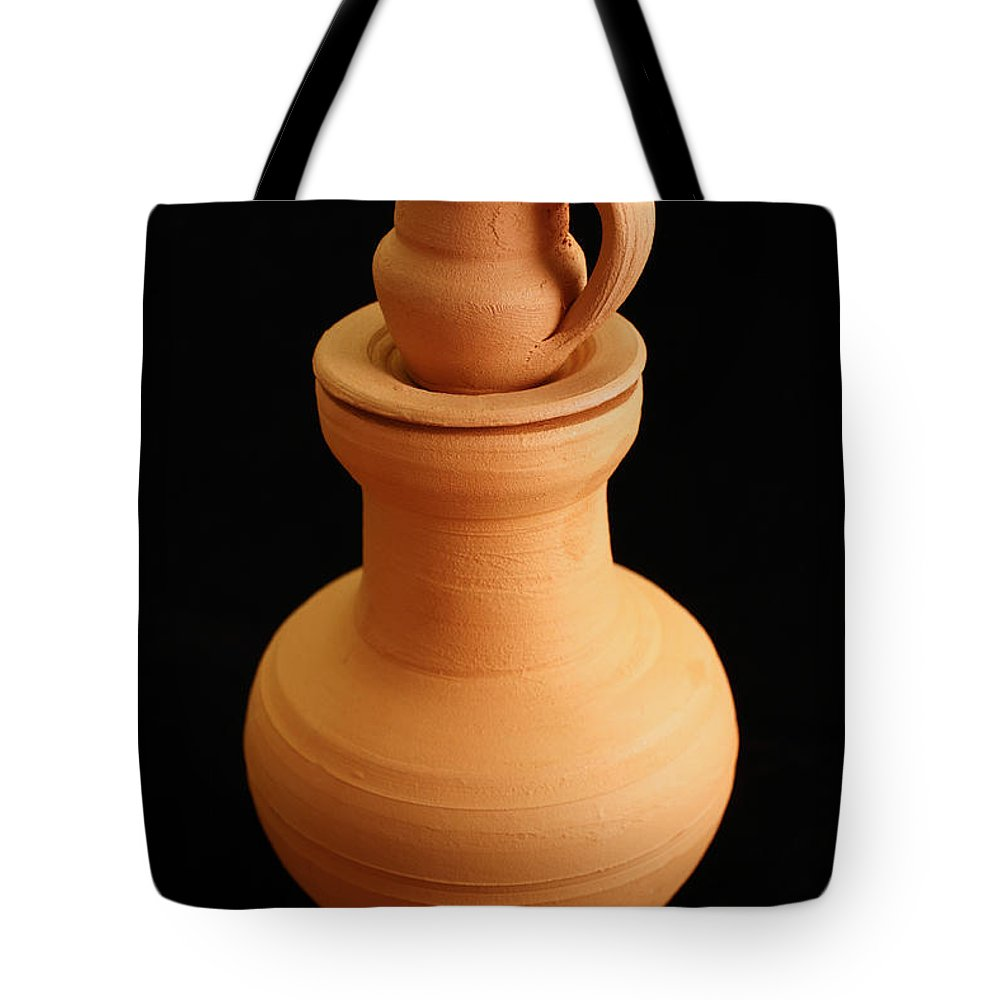 Pottery Tote Bag featuring the photograph Small Pottery Items by Gaspar Avila