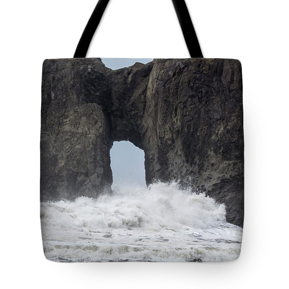 Stone Tote Bag featuring the photograph Storm Rock by Benjamin Hanna