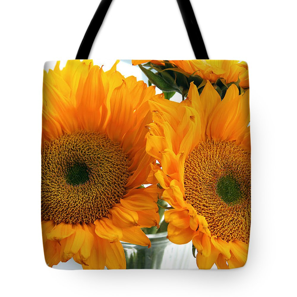 Sunflowers Tote Bag featuring the photograph Sunflowers by Todd Blanchard